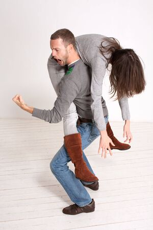 man carrying: young couple piggyback indoor