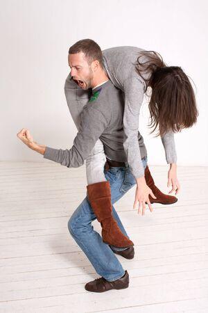man carrying woman: young couple piggyback indoor