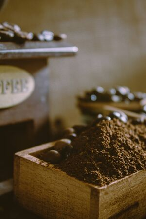 still life with coffee beans and old coffee mill on the rustic background