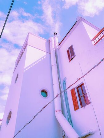White fantasy house overlooking the sky in the Mediterranean. Typical house of Mallorca and menorca. Imagens