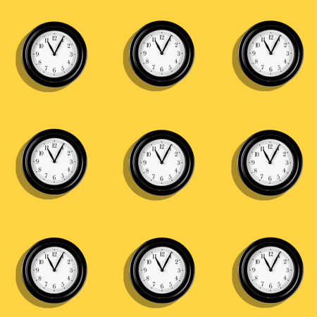 A Classic hand clocks pattern on yellow background. Time passing concept with clock pointing at 11 in the morning.
