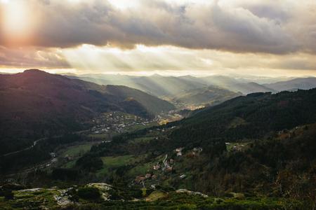 Lightbeams enlighten the valley Stockfoto