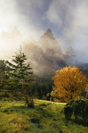 Lush green scenic valley below majestic rugged rocky mountain peaks in the Monestir de Montserrat Region near Barcelona Spain a popular tourist destination