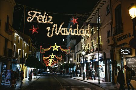 Feliz Navidad Christmas lights in Ronda, Andalusia 스톡 콘텐츠