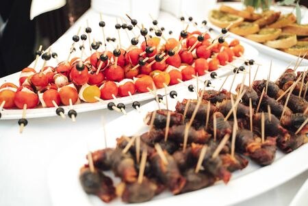 Platter with cheese and cherry tomato snacks