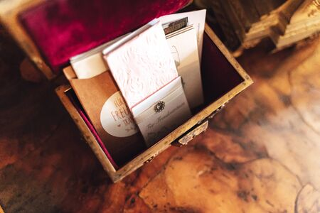 Vintage wooden box with festive paper tissues for tears of happiness. Wedding day concept.