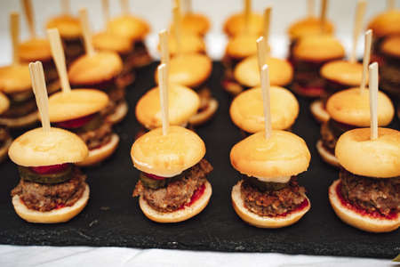 Close up of tasty mini burger with meat served at wedding party