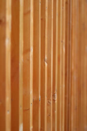 Closeup view of a wall made of wooden posts