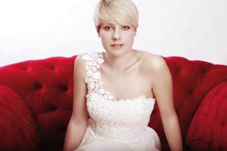 awesome young short haired blonde girl with bridal dress