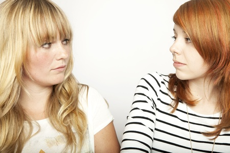 blond and red haired girl are upset and disappointed Stock Photo
