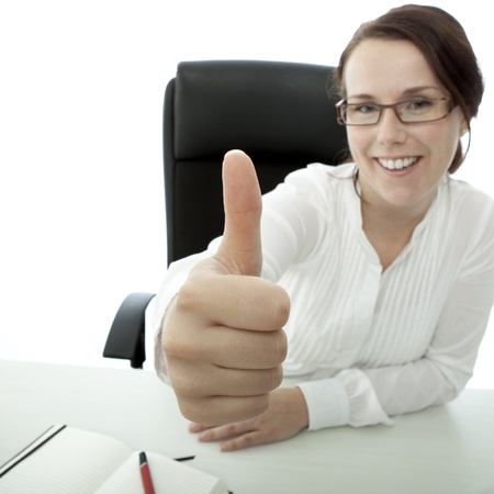 young brunette businesswoman with glasses thumb up photo