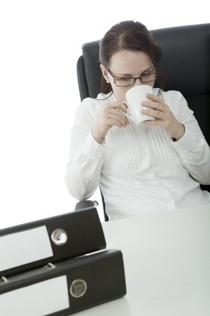 young brunette businesswoman with glasses relaxing and drinking coffee photo