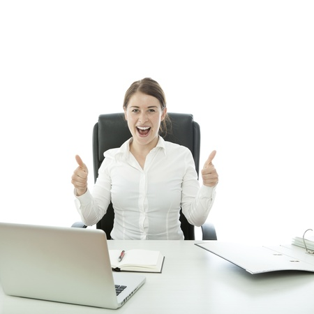 young brunette business woman thumb up on desk Stock Photo - 14724972