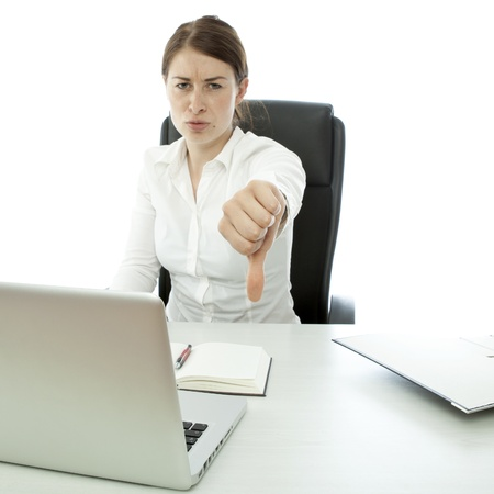 young brunette business woman thumb down on desk Stock Photo - 14724961