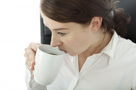 young brunette business woman drinking cup coffee Stock Photo - 14724992