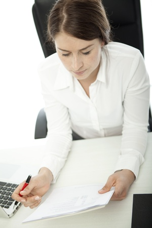 young brunette business woman thinking over documents Stock Photo - 14724987
