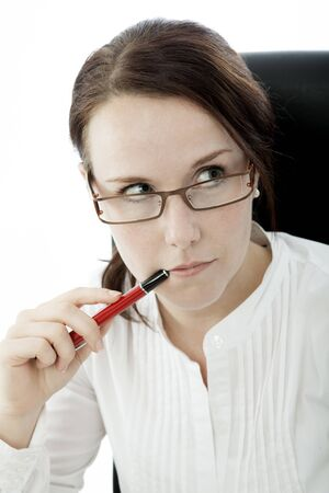 young brunette business woman with glasses and pen thinking Stock Photo - 14724990