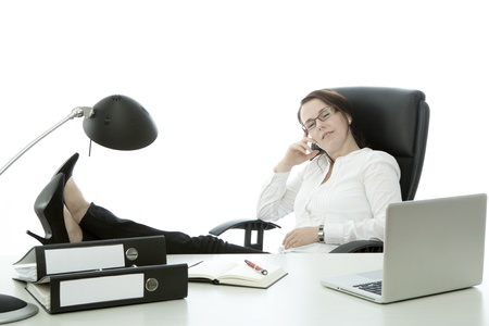 young brunette businesswoman with glasses relax with feet on desk photo