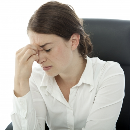 young brunette business woman headache touch head with finger