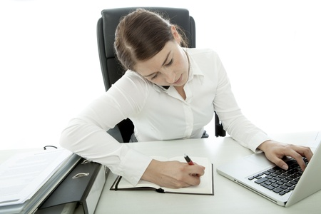 young brunette business woman busy with telefon and laptop