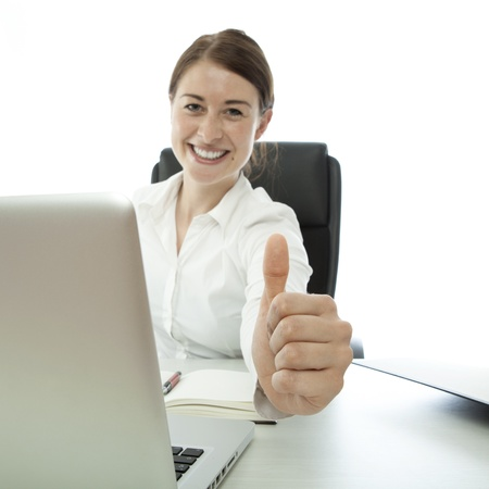 young brunette business woman thumb up on desk