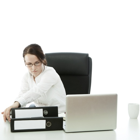 young brunette businesswoman with glasses want to throw lapotp of desk photo