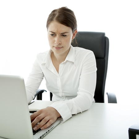 young brunette woman is uncertain on desk Stock Photo - 14767589