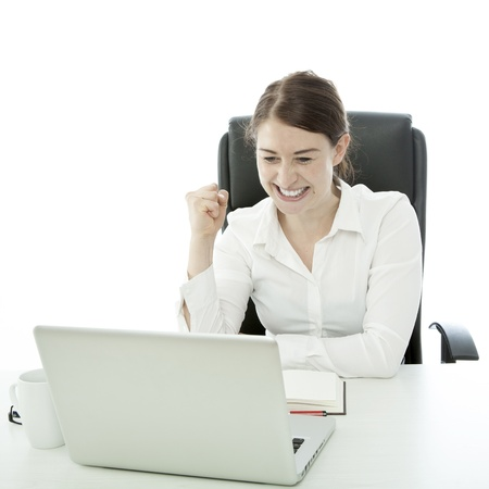 hurray: young brunette business woman is happy behind laptop Stock Photo