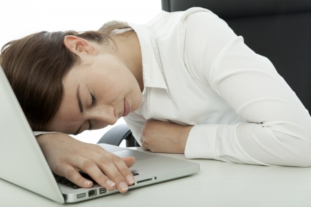 young brunette business woman fall asleep on computer Stock Photo - 14767609