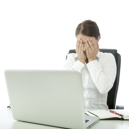 young beautiful brunette woman is depressed on desk Stock Photo - 14767590