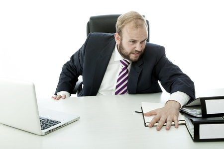 beard business man is angry and throw documents desk photo