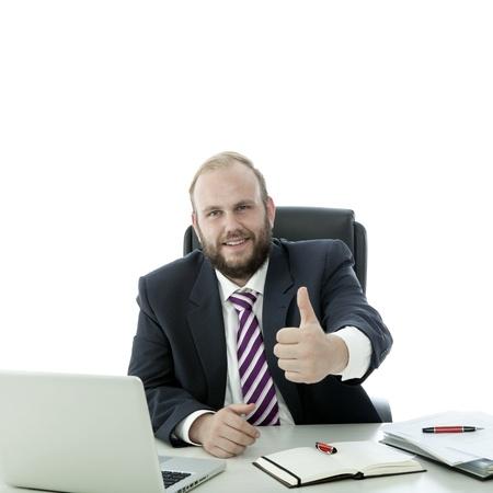 beard man thumb up at the desk Standard-Bild