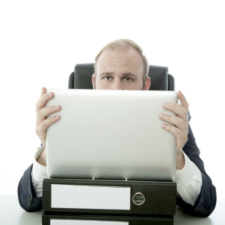 business man hide behind laptop and document