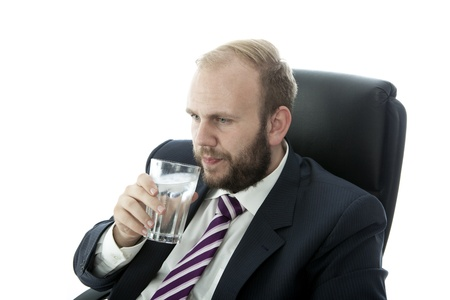 beard business man drink glass water work photo