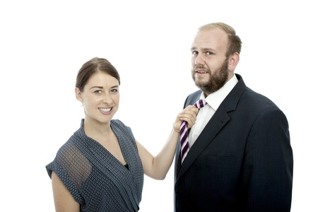 young brunette woman and beard business man pulls tie