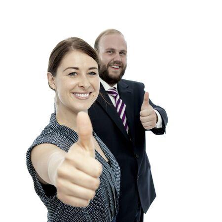 beard woman: young brunette woman and beard business man thumbs up Stock Photo