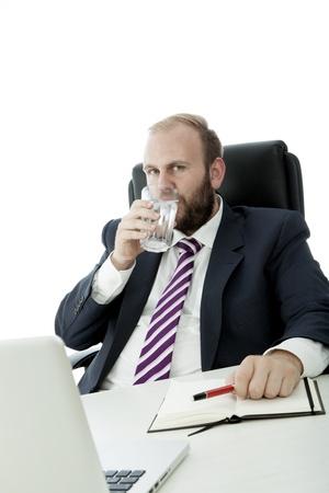 beard business man drink glass water work photo