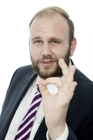 okay sign: beard business man say its perfect with finger Stock Photo
