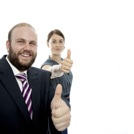 people looking up: young brunette woman and beard business man thumbs up Stock Photo
