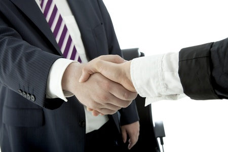 client meeting: handshake of business man and woman in suit