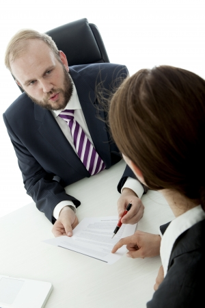 beard business man brunette woman at desk signs contract photo