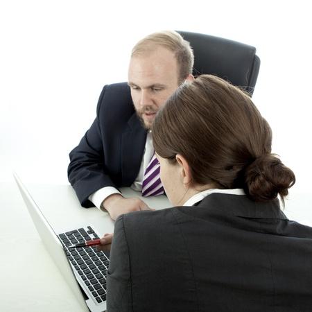 beard business man brunette woman at desk explain at laptop photo
