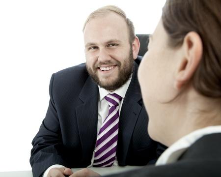 beard business man brunette woman at desk  happy