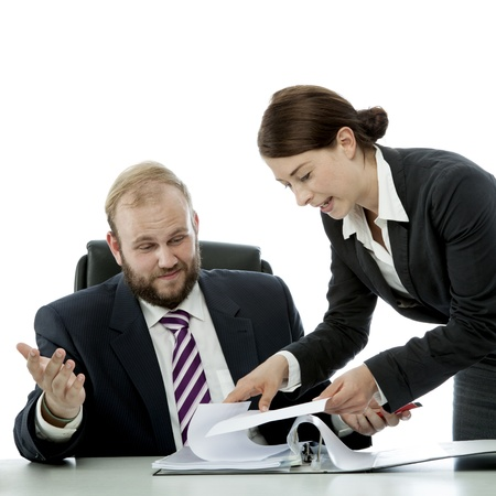 beard business man brunette woman at desk confusing