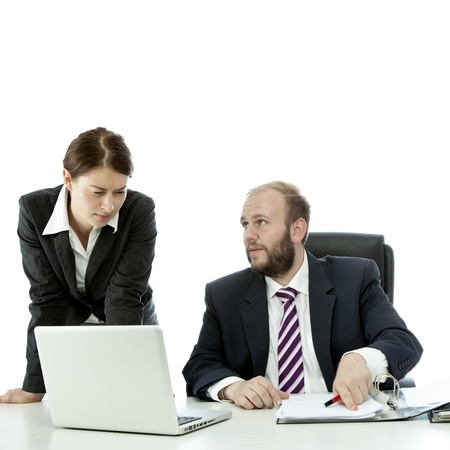 beard business man brunette woman at desk show documents Stock Photo - 14943254