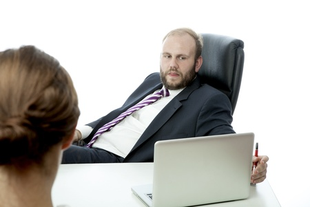 beard business man brunette woman at desk ignoring photo