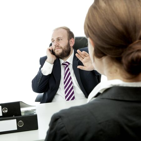 beard business man brunette woman at desk sign quiet