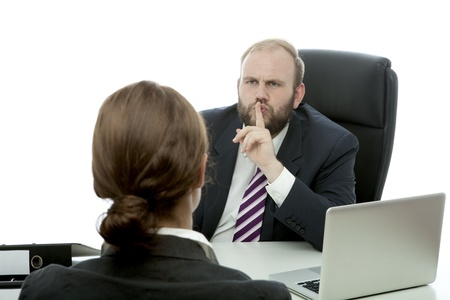 beard business man brunette woman at desk has secret Stock Photo - 14957453