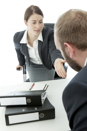 beard business man brunette woman at desk ask  sit down photo
