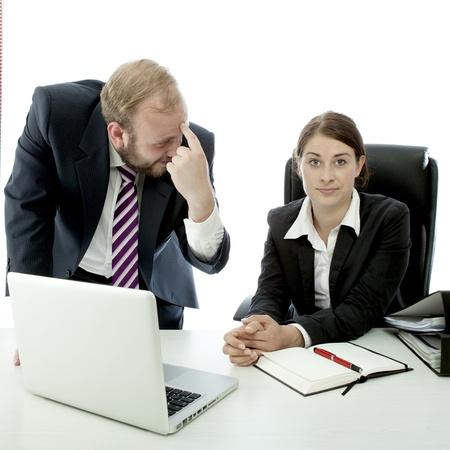 beard business man brunette woman at desk employee is stupid photo